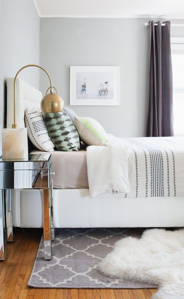 Bedroom with layered rugs