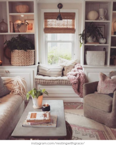 cozy living room with blankets and pillows